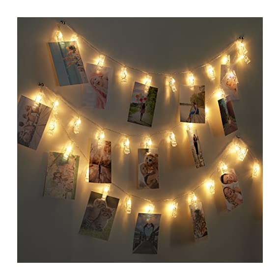"""AMIR LED Photo Clip String Lights, 40 LED Photo Clip Lights, 5M Starry Wall Decoration Light, Picture Lights, Hanging Memorable Photo, Notes, Postcard, Artwork, Warm White - 40 CLEAR PHOTO CLIPS: AMIR Photo Clip String Lights have 40 clear clips, total length 5m, each clips 12cm/4.5inches apart. Enough space for hanging multiple photos, postcards, or artworks, satisfying your desire to show your favorite views. STURDY CLIP&SIMPLE INSTALLATION: The clips of the clip string light are in good quality. Each clips can nip photos or other small items tightly and no worry about falling off. Simple installation for decorate walls, windows, book shelves, mirror etc. TWO MODES DESIGN: The clip string light has two modes, normal mode and flashing mode. The flickering light with """"One button operation design"""" will provide you a romantic environment. - patio, outdoor-lights, outdoor-decor - 51un3XVI95L. SS570  -"""