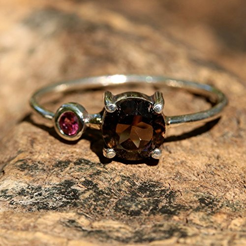 faceted-smokey-quartz-ring-in-silver-prong-setting-with-secondary-garnet-gemstone-in-2mm-silver-roun