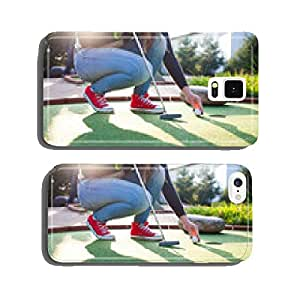 Young woman plays adventure/mini golf in summer evening cell phone cover case Samsung S5