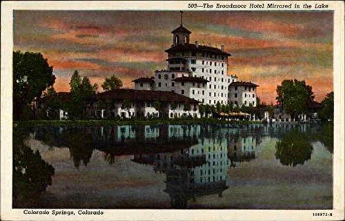 The Broadmoor Hotel mirrored in the lake Colorado Springs, Colorado Original Vintage Postcard