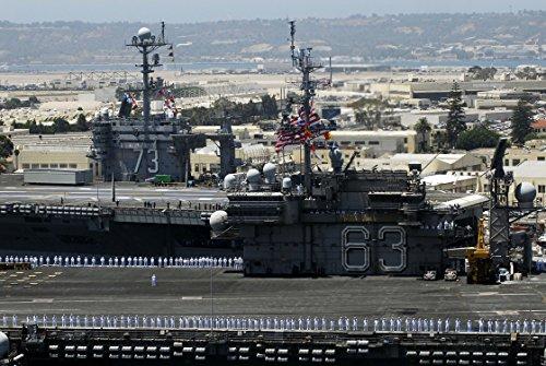 The aircraft carrier USS Kitty Hawk (CV 63) sails past the nuclear-powered aircraft carrier USS Geo