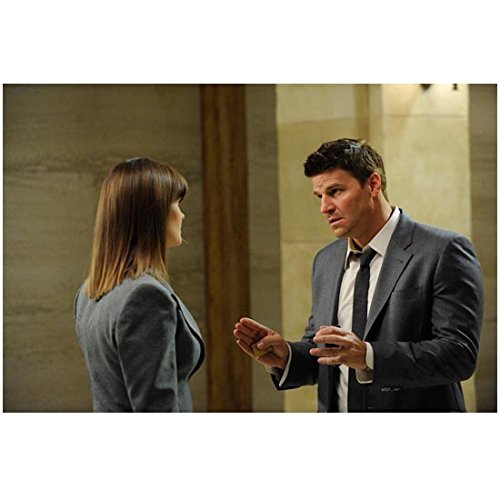 Bones David Boreanaz as Special Agent Booth Holding Hands Partly Up Towards Emily Deschanel Dr. Brennan 8 x 10 Photo