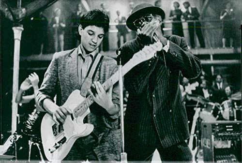 Vintage photo of Ralph Macchio like Eugene and Joe Seneca as Willie Brown in the movie