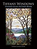 img - for Tiffany Windows Stained Glass Pattern Book (Dover Stained Glass Instruction) by Eaton, Connie Clough (1997) Paperback book / textbook / text book