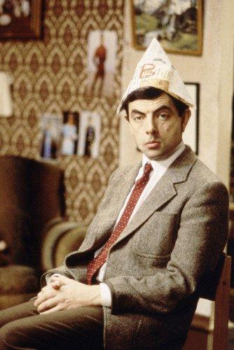 Mr Bean Christmas.Rowan Atkinson Mr Bean 24x36 Poster Sitting In Chair Christmas Hat