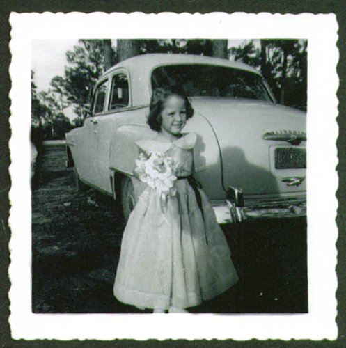 1st Communion Girl & 1952 Plymouth Club Coupe snapshot