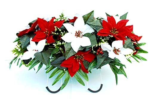 Cemetery Headstone Decoration for Christmas with Red and White Poinsettias with Holly as a Saddle