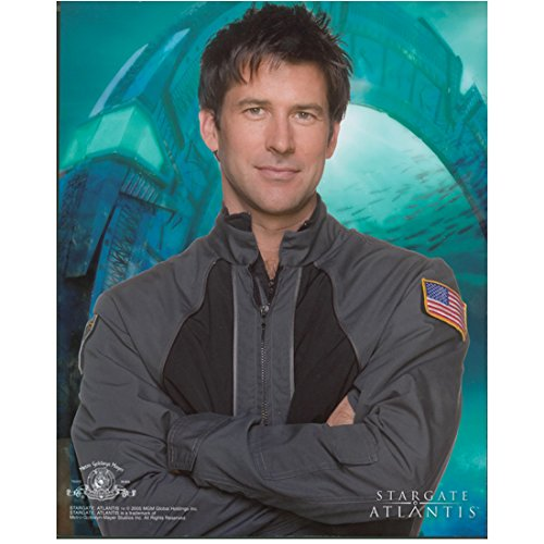Joe Flanigan 8x10 Inch Photo Stargate Atlantis 6 Bullets The Other Sister Cute Smile Arms Crossed Stargate in Background kn