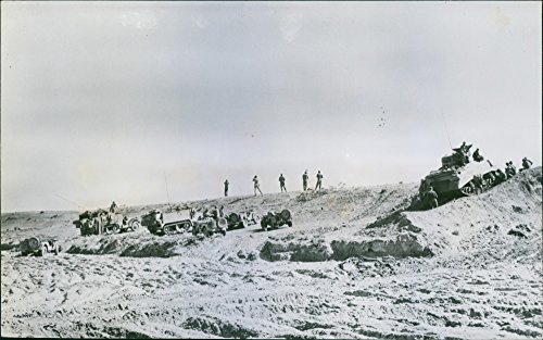 Vintage photo of 1943A unit of American armored forces gathers behind a front line observation post preparing to launch the successful American counter attack at Kasserine Pass, Tunisia.