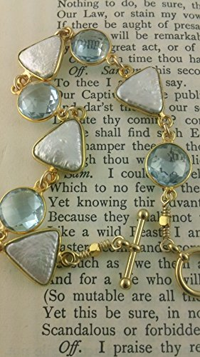 Bracelet of Caribbean Blue Topaz Coins with triangle freshwater pears hand wrapped in golden -