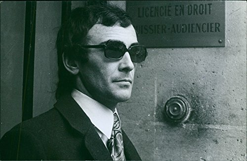 Vintage photo of Portrait of a court usher wearing black sunglasses, 1971. for $<!---->