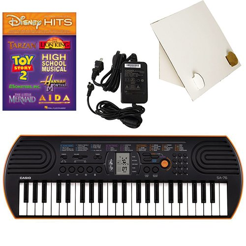 Price comparison product image Casio SA-76 44 Key Mini Keyboard Deluxe Bundle Includes Bonus Casio AC Adapter,  Desktop Music Stand & Disney Hits Beginning Piano Solo Songbook