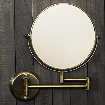 Hotel Quality 8 Magnification Wall Mount Swing Arm Mirror. Two-Sided Regular 7X Magnification. Brushed Brass Finish.