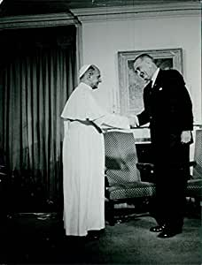 Vintage photo of Lyndon B. Johnson shaking hand with man.