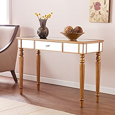 "Brandilyn Mirrored Media Console Table - Champagne Gold Finish - Glam Style - Features 1 drawer with black fabric lining; Smooth metal drawer glides for lasting use Hollywood regency style; Mirrored with champagne gold finish and crystal style knob Overall: 42"" W x 16.75"" D x 29.25"" H; Tabletop mirror: 40.5"" W x 15"" D; Drawer: 16"" W x 11"" D x 3"" H; Clearance: 36"" W x 10"" D x 23.75"" H - living-room-furniture, living-room, console-tables - 51vi IqccyL. SS400  -"