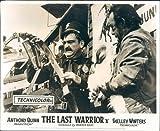 Last Warrior Anthony Quinn original lobby card police man looks at gunbelt