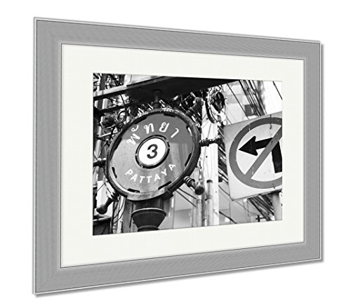 Ashley Framed Prints Street Sign Pattaya 3 In English And Thai Next To A No Left Turn Sign, Wall Art Home Decoration, Black/White, 30x35 (frame size), Silver Frame, AG5892511 by Ashley Framed Prints