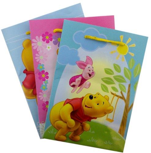 4 Piece Winnie the Pooh Medium Size Gift ()