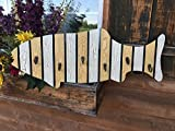 This Fish with hooks is a perfect coat rack or towel rack! It's sturdy, unique, great for a lake home, cabin, bathroom, or for any fish lover (fisherman)! It would make a great gift as well! *This is a beautiful handcrafted wood fish with met...