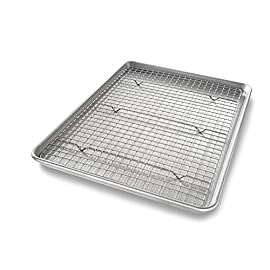 USA Pan Bakeware Quarter Sheet Baking Pan and Bakeable Nonstick Cooling Rack Set, Metal 27 Classic half sheet pan and cooling rack for baking and roasting cookies, vegetables, and cakes; commercial grade and heavy gauge aluminized steel Baking pans feature unique corrugated surface; facilitates air flow for quick release and evenly baked goods; cooling rack has crosswire design and six raised feet for stability and uniform cooling Nonstick Americoat coating - a patented silicone coating which is PTFE, PFOA and BPA free - provides easy release of baked-goods and easy clean up; wash with hot water, mild soap and gentle sponge