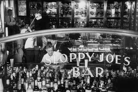 (Photo Alec Guinness (front) in Sloppy Joe's Bar Cuba)