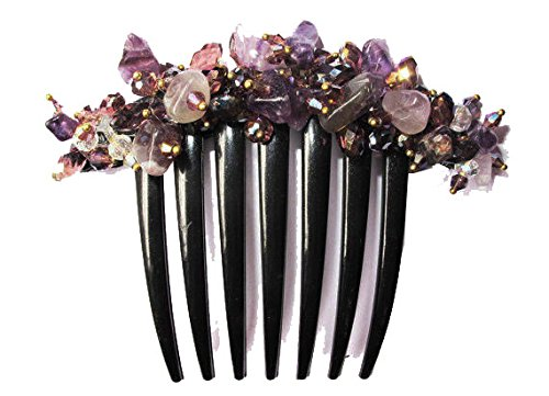 French twist hair comb Ornamented along the top of the heading with Stone Purple.