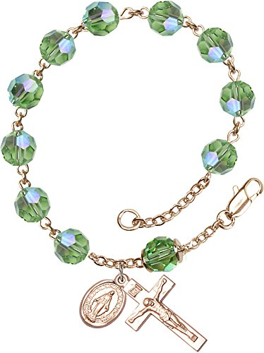 Crucifix Peridot (8mm Imitation Peridot Swarovski, Capped Our Father Aurora B-14 Karat Gold Rosary Bracelet features 8mm Imitation Peridot Swarovski, Capped Our Father Aurora Borealis beads. The Crucifix measures 7/8 x 3/8.-Each Rosary Bracelet is presented in a deluxe velvet gift box. Hand-crafted in the USA by a group of talented artisans at Bliss Manufacturing,each piece of jewelry comes with a lifetime guarantee against breakage, manufacturing defects and tarnishing)