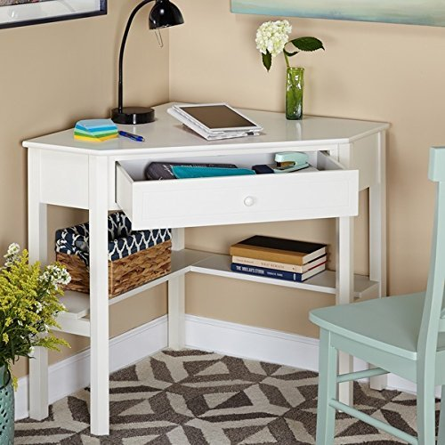 This classically styled desk utilizes a small space for a big impact, with stylish under-desk shelving and a drawer to hide clutter. Simple Living Wood Corner Computer Desk (Antique White) (Corner White Desks)
