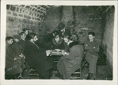 - Vintage photo of During the bombing of Paris. A family take shelter in a wine cellar