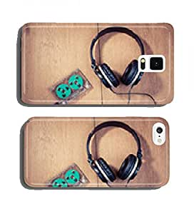 Retro compact cassette with rolls and headphones on wood cell phone cover case Samsung S4 mini