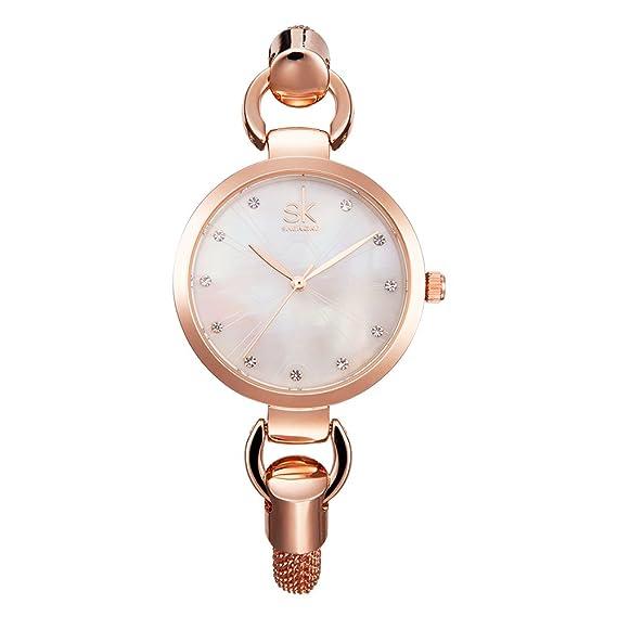 SHENGKE K0026 rosa de oro femenino relojes de cuarzo mujer hueca pulsera señoras vestido de lujo reloj de pulsera: Amazon.es: Relojes