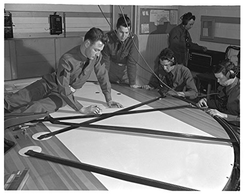 1942 Photo Fort Story. Coast artillery. In this coast artillery plotting room at Fort Story, Virginia, officers who direct the firing of the big guns work out the problems that are a part of gunnery