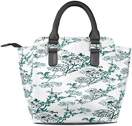 Sac à main en cuir avec motif de fleurs vertes et blanches