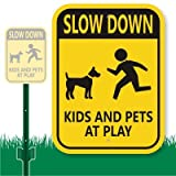 "SmartSign heavy duty aluminum sign, header ""LawnBoss Sign and Stake Kit"", legend ""Slow Down Kids And Pets At Play"" with Kid and Dog Graphic. Signs last 10+ years outdoor life. Great water and chemical resistance. Mounts with screws or clips. ..."