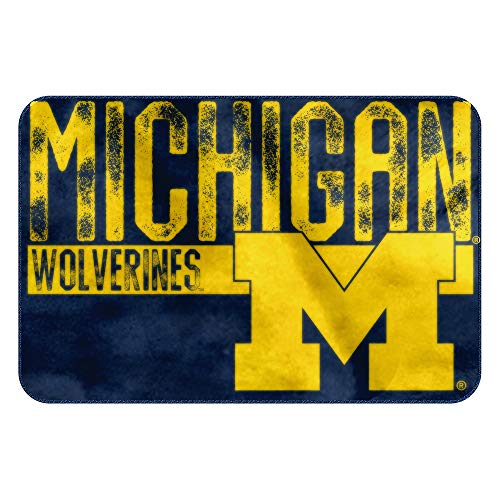 - The Northwest Company NCAA Michigan Embossed Memory Foam Rug, One Size, Multicolor