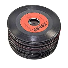 "Randomly chosen, mixed lot of 7"" (45 speed) vinyl records from various years and genres. These genuine vinyl records can be used to craft decorations, artwork, guitar picks, home or store decor items and such, or just to hang to give t..."