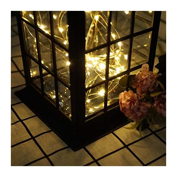 Solar Outdoor Lantern, Waterproof Hanging Solar Lantern with 30 LED Fairy Copper String Lights for Patio, Garden, Lawn, Pathway (Warm White) - CLASSIC DESIGN: Simple and elegant black frame rectangle shape with 30 LED warm fairy string lights, create a unique retro romance. SAFE LONG LIGHTING: Choosing the most popular string of lights inside the lantern instead of traditional candles, guarantees sufficient illumination without the danger of open flames. And after full charged, the solar lantern will automatically turn on at night and light up for 8 hours. PERFECT OUTDOOR DECOR: A movable hanging ring can be easily hung on anywhere, very suitable for your balcony, hallway, porch, courtyard, patio, garden, lawn. - patio, outdoor-lights, outdoor-decor - 51wTJn9dPCL. SS570  -