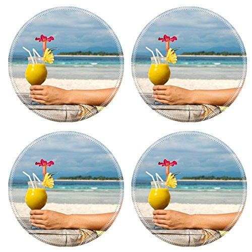 msd-natural-rubber-round-coasters-image-id-12598775-woman-holding-a-fruit-cocktail-on-a-tropical-bea