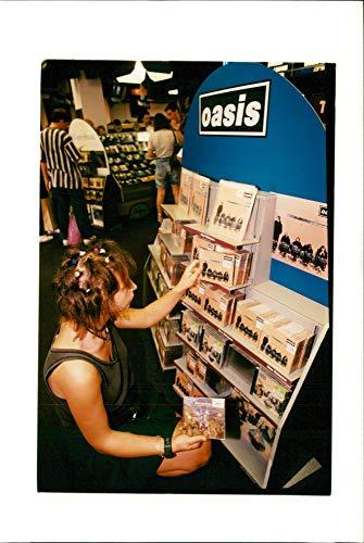 (Vintage photo of Blur V Oasis record sales. )