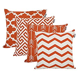 Pillows with white and orange geometric designs