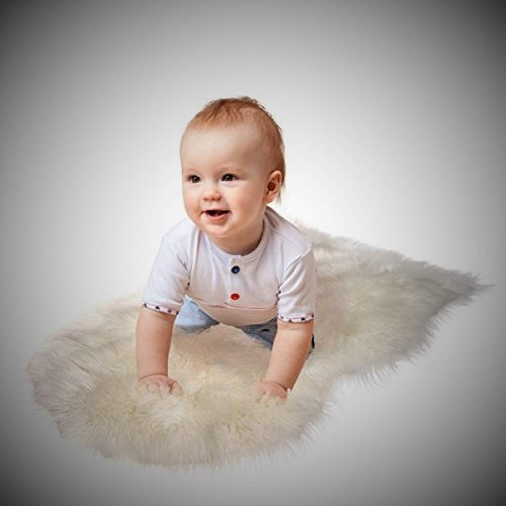 Super Soft Sheepskin Rug By CUSHIMAX - Excellent Quality Faux Fur Rug - Modern, Stylish Design - Used As An Area Rug Or Across Your Armchair - Cozy Feeling Like Real Wool - Back Lining Suede Fabric by CUSHIMAX