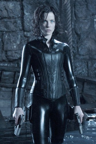Kate Beckinsale Underworld cool pose in leather holding two