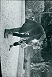 Vintage photo of Jane Fonda and Alain Delon playing shot put.
