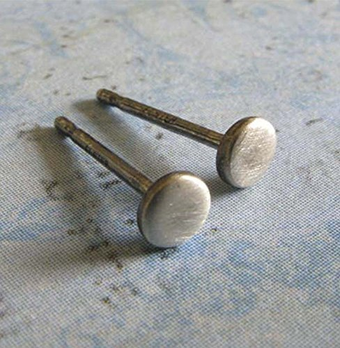 Teeny tiny stud earrings brushed sterling silver dot posts. Handmade in the USA.