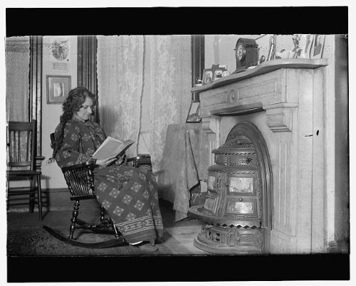 HistoricalFindings Photo: Woman in Front of Coal Stove,c.1914,Unidentified Location,Home Life
