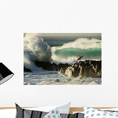 Wallmonkeys Surf Crashing near Surfer on Boulders Wall Decal Peel and Stick Graphic WM2086 (24 in W x 16 in H)