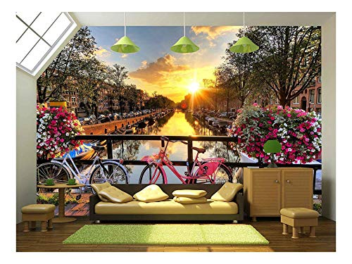 wall26 - Beautiful Sunrise Over Amsterdam, The Netherlands, with Flowers and Bicycles on The Bridge in Spring - Removable Wall Mural | Self-Adhesive Large Wallpaper - 66x96 inches