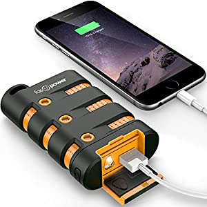 Orange and black power bank connected to phone