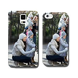 Family of four choosing X-tree at market cell phone cover case Samsung S5