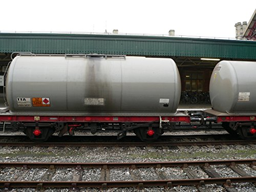 (Home Comforts Laminated Poster One of Twelve or Thirteen Tanker Wagons of a southbound Freight Service detained at a red Signal at Vivid Imagery Poster Print 24 x 36)